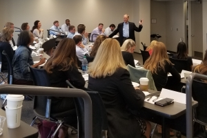 A photo of Dr. Jack Cathey of Belk College teaching during an AMP session held at UNC Charlotte Center City.
